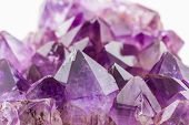 picture of purple white  - Crystal Stone purple rough amethyst crystals on texture background - JPG