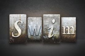 stock photo of swim meet  - The word SWIM written in vintage letterpress type - JPG