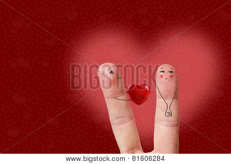 Finger art of a Happy couple. Man is giving red heart. Stock Image