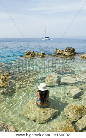 woman relaxing in the clear blue sea