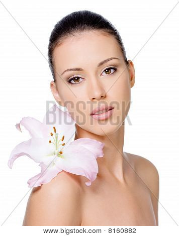 Woman With Healthy Skin With Lily