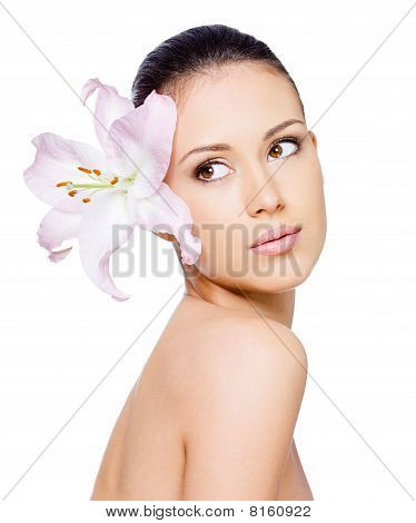 Beautiful Woman With Flower In Hair
