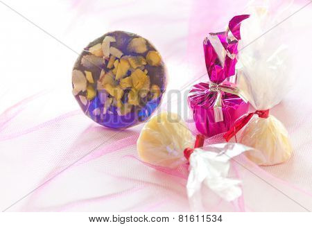 Group of handmade chocolate in shiny wrapper on a colorful background