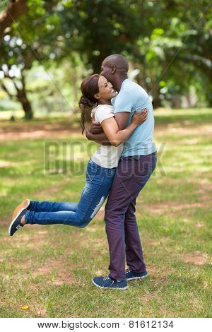 playful young african couple having fun in the park