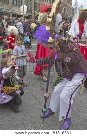 Mardi Gras Clown Waving To Kids