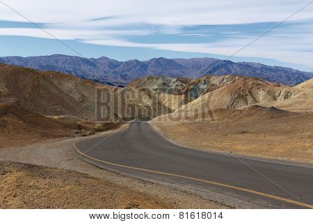 Curved aspalted road in heart of Death Valley