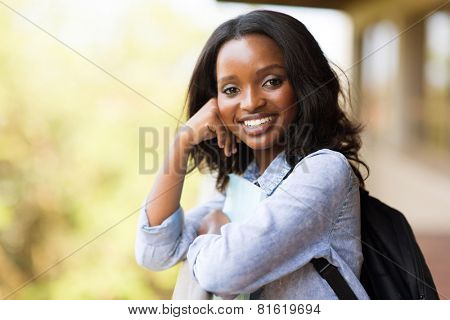 pretty afro american college girl looking at the camera