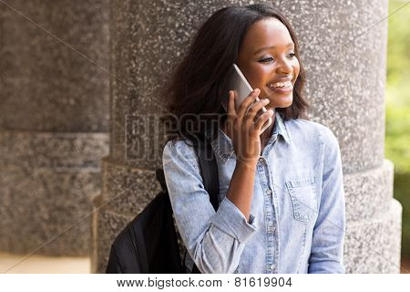 pretty african american college student making a phone call