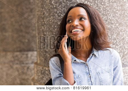 happy african college girl talking on mobile phone