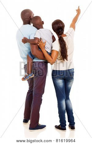 rear view of afro american young family pointing at empty space isolated on white background