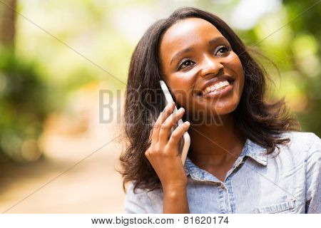 beautiful afro american woman talking on mobile phone