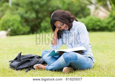 pretty afro american university student studying outdoors