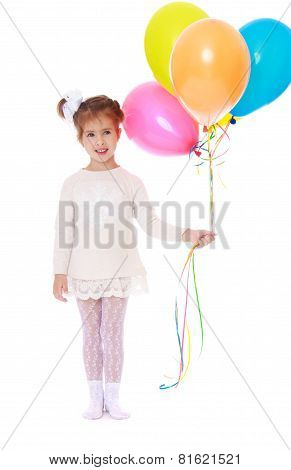 Beautiful little girl in a white dress