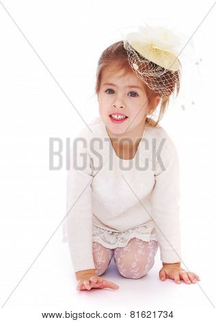 Beautiful little girl in a fashionable hat.
