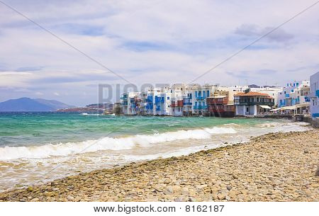 The Waves On The Sea And Clouds In The Sky Over The Little Venice In Mykonos Island