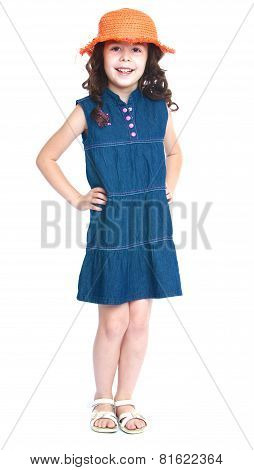 Girl in jeans dress and hat.
