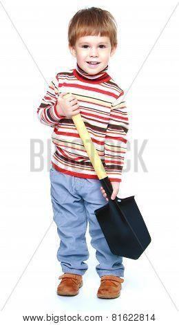Little boy holding a large Sapper shovel.
