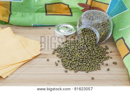 Green Mung Beans With Glass Jar On Wooden Board