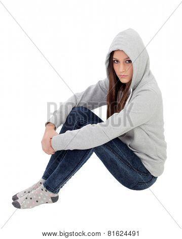 Angry hooded girl with grey sweatshirt sitting on the floor isolated