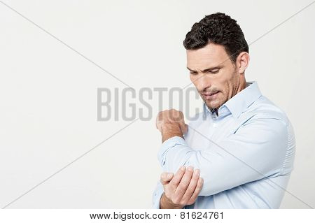 Man with Hand on Elbow