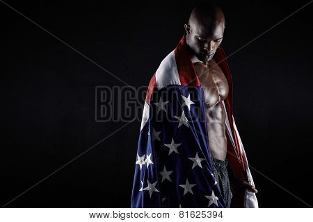 Muscular Man Wrapped In The American Flag With Copy Space