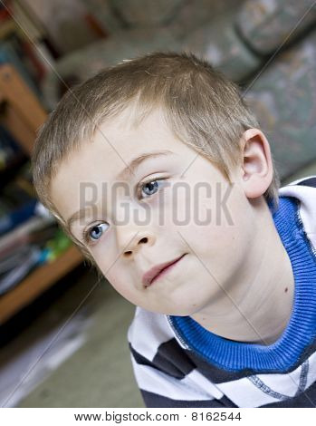 Candid Close Up Portrait Of A Cute Six Year Old Boy