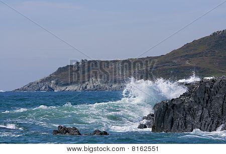 Waves Crashing Over A Rocky Headland