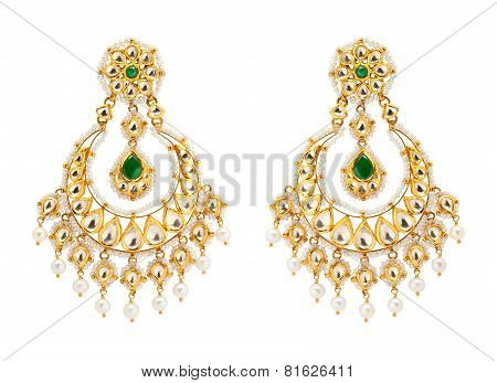 Close up of gold and diamond earrings
