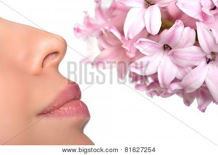 Close-up nose and a flower. Allergy to pollen of flowers. asthma attack.  Floral fragrance, perfumes
