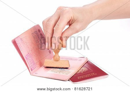 Female Hand Stamping A Passport Of Russia