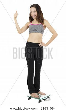 Woman Giving Thumbs Up Because Of Weight Loss