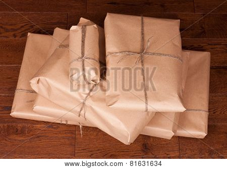 Vintage gift box package on wooden background.
