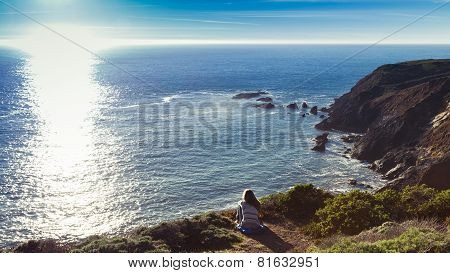 Girl Overlooking Ocean