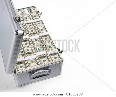 Open silver grey briefcase filled with 100 USD notes