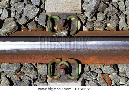 Iron Rusty Train Railway Detail Over Dark Stones