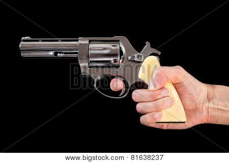 Handgun on the black background