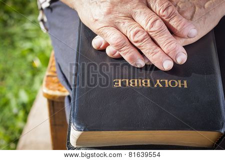 Old Woman Hands On Holy Bible