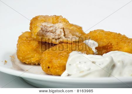 Fried Golden Chicken Nuggets On A Plate With Tartar Sauce