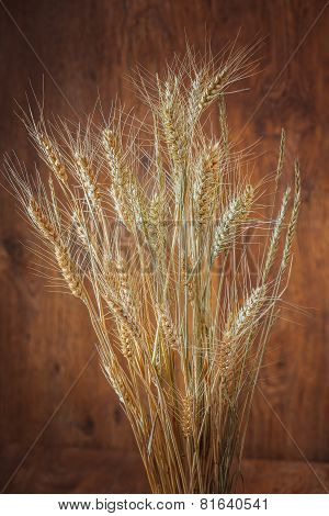 Rye Spikelets On Wooden Background