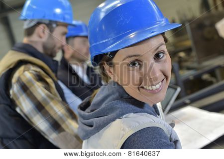 Cheerful woman industrial engineer at work
