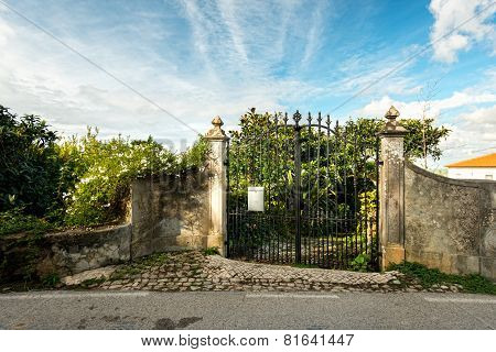 wrought iron gates near the house  garden