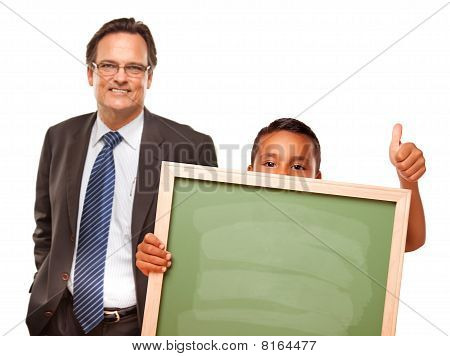 Hispanic Boy Holding Chalk Board With Male Teacher Behind