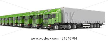 Green Cargo Trucks Parked In A Row