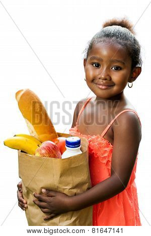 Cute African Kid Holding Groceries In Brown Bag.