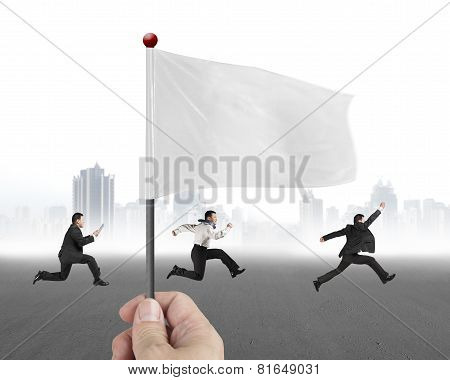Hand Holding Flag With Three Businessmen Running And Cityscape Background