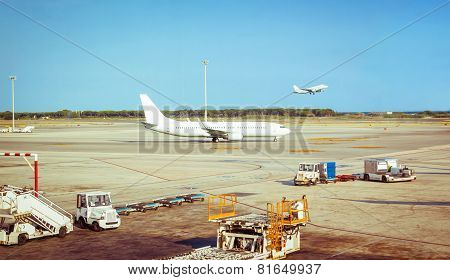 Airplane in airstrip ready to flight and plane taking off