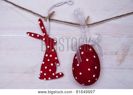 Red Easter Bunny And Easter Egg Hanging On Line