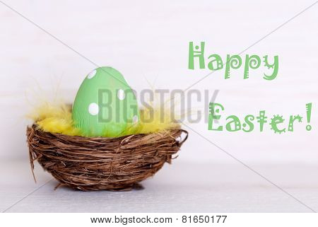 One Green Easter Egg In Nest With Happy Easter