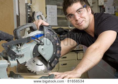 Carpenter at work on job using power tool