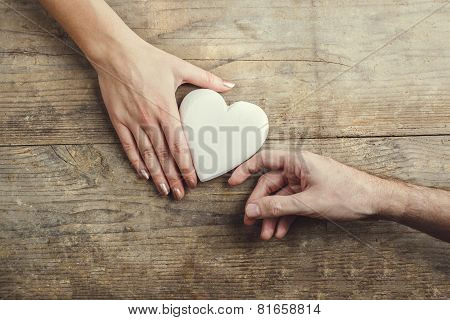 Man offering a heart to a woman.